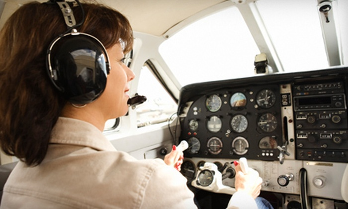Skylink Aviation - Saint Charles: One-Hour Introductory Lesson or a Tour of St. Louis for Two from Skylink Aviation in Portage Des Sioux (Up to 52% Off)