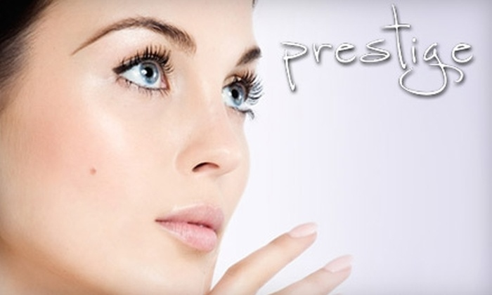 Prestige Salon & Spa - Spanish Fork: $25 for Spa Manicure and Pedicure or Two Airbrush Tans at Prestige Salon & Spa (Up to $60 Value)