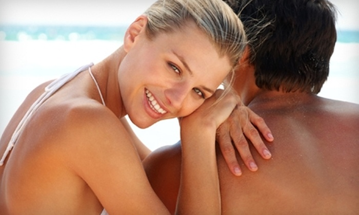 Tan and Laundry Connection - Multiple Locations: $10 for Four Tanning Sessions (Up to $32 Value) or $25 for Two Spray Tans ($60 Value) at Tan and Laundry Indianapolis