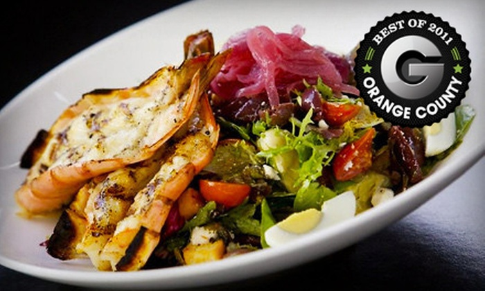 Mozambique - Woods Cove: $25 for $50 Worth of South African Cuisine and Drinks Sunday–Friday or Any Day of the Week at Mozambique in Laguna Beach