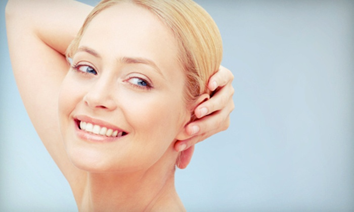 World of Health - Multiple Locations: One Microdermabrasion with Fruit-Enzyme Peel and Masque or Four Microdermabrasions at World of Health (Up to 53% Off)