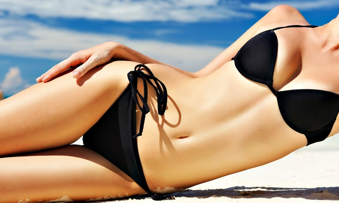 Darque Tan - Multiple Locations: Two Spray Tans, Five UV Tans, or One Month of UV Tanning at Darque Tan (Up to 79% Off)