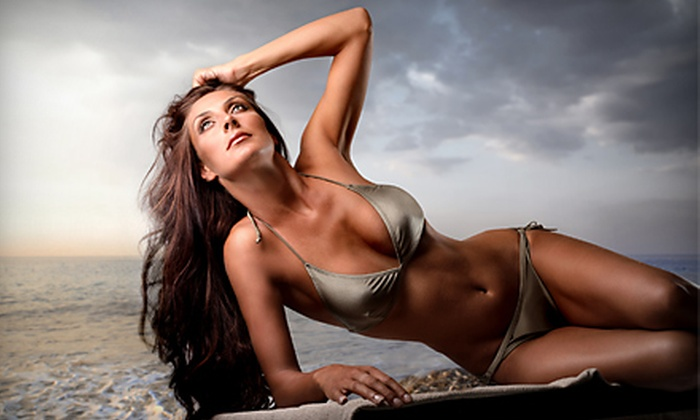 Tan Tan Room - West Bloomfield: $19 for Two Mystic Spray Tans or One Month of Unlimited UV Tanning at Tan Tan Room in West Bloomfield (Up to $50 Value)