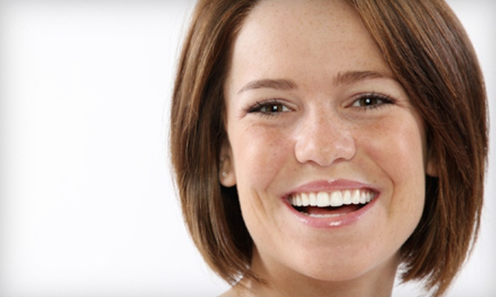 Smiling Bright - Midtown: $29 for a Teeth-Whitening Kit with LED Light from Smiling Bright ($180 Value)