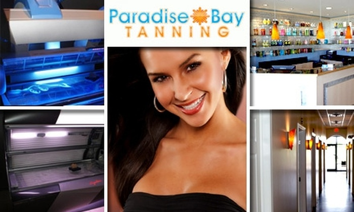Paradise Bay Tanning - Multiple Locations: $20 for One Month of Unlimited Tanning or Two Spray Tans at Paradise Bay Tanning