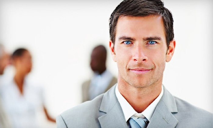 Nora's Design Group - Kettering: $15 for a Men's Haircut and Neck Shave Package with Steam Towel and Scalp Massage at Nora's Design Group ($32 Value)