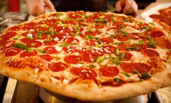 The Pizza Machine & Co. - Gallatin: $10 for $20 Worth of Hand-Tossed Pizza, Calzones, and Drinks at The Pizza Machine & Co. in Gallatin