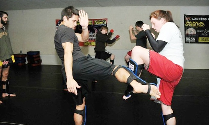 Westside MMA - Multiple Locations: $59 for One Month of Kickboxing Lessons and a Pair of Boxing Gloves at Westside MMA ($148 Value)