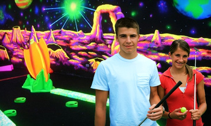 Space Golf - Orland Park: $15 for a Glow-in-the-Dark Mini-Golf Outing for Four at Space Golf in Orland Park (Up to $32 Value)