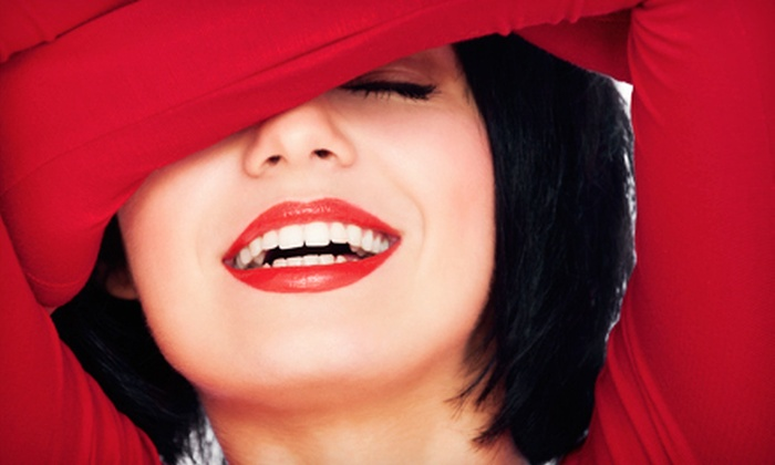 Tanning Zone - West A: $59 for a 45-Minute Teeth-Whitening Treatment at Tanning Zone ($149 Value)