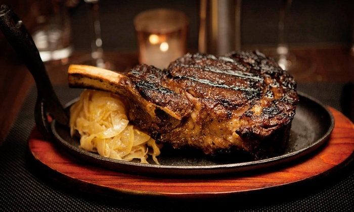 Delmonico's Kitchen - Garment District: $80 for $150 Worth of Gourmet Steaks, Seafood, and Dessert