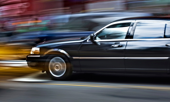 City Limousine - Burlington Town Center: One-Way or Roundtrip Sedan Service for Up to Four to and from Logan Airport from City Limousine (Up to 54% Off)