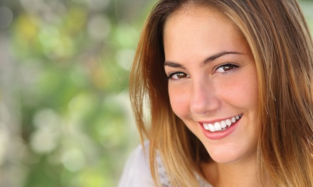 Cleaning, XRay, and Exam, with Optional Whitening Treatment at Dentists on Madison (Up to 88% Off)