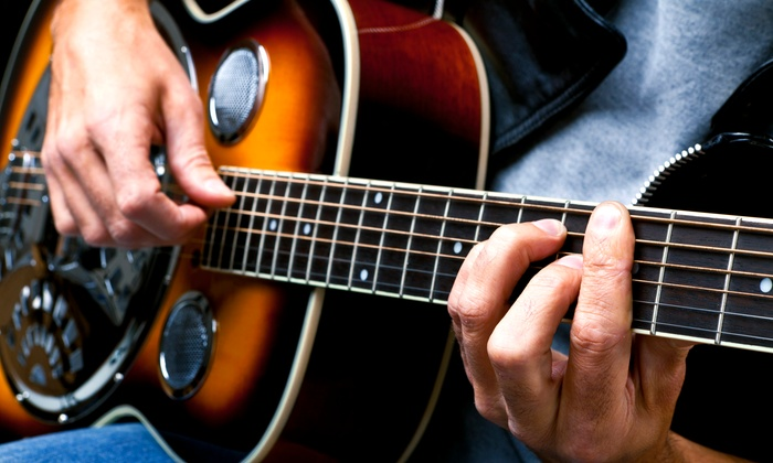 Anderson Music Studios - West 10th: Two or Four 30-Minute Private Guitar Lessons at Anderson Music Studios (Up to 50% Off)