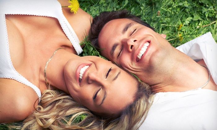 Center for Oral Health - Multiple Locations: Complete Invisalign Treatment or Dental Exam, Cleaning, and X-rays at Center for Oral Health (Up to 89% Off)