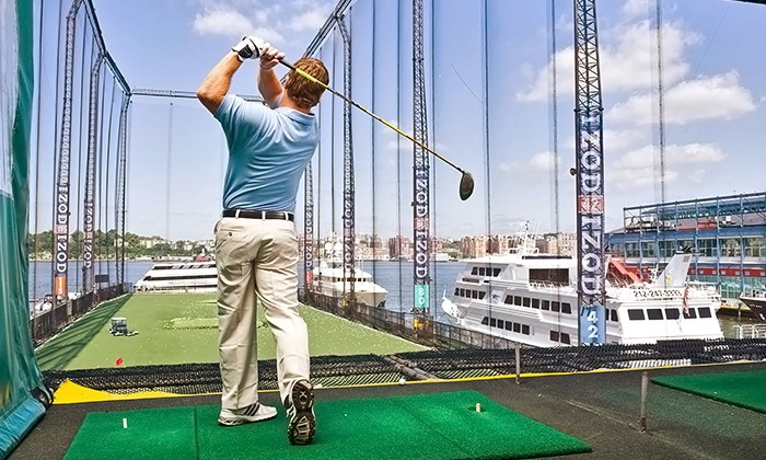 Golf Club at Chelsea Piers - Chelsea Piers: Golf-Class Packages with Range Balls at Golf Club at Chelsea Piers (Up to 60% Off). Three Options Available.