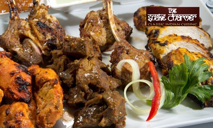 Indian Banquet plus Wine for Two $49.9 or Four People $95 at The Snake Charmer Indian Banquet Up to $286 Value