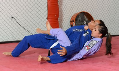image for $31 for One Month of Brazilian Jiujitsu or Muay Thai Classes at Roots Kickboxing ($139 Value)