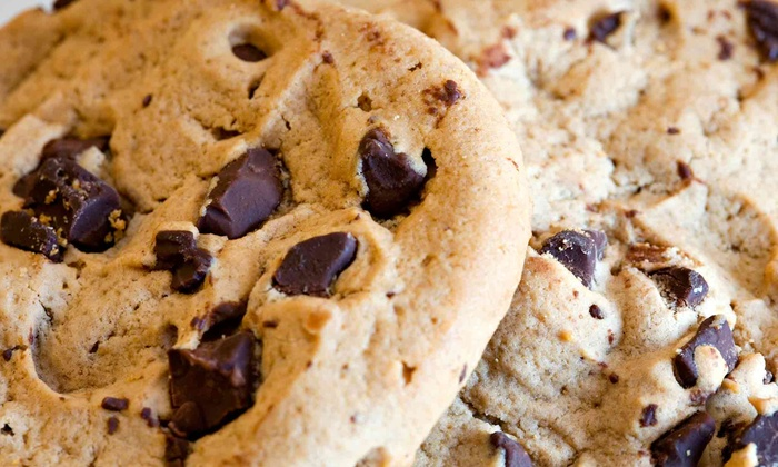 Mrs. Fields - Multiple Locations: Large Cookie Tin or Half-Sheet Cookie Cake at Mrs. Fields (49% Off)