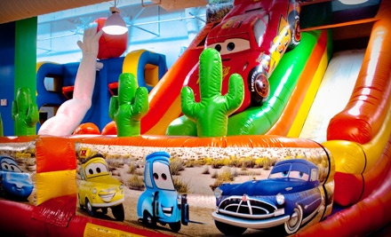 Full-Day Unlimited Bounce-House Admission for Two or Four with Arcade Tokens at bounzCity (Up to 48% Off)
