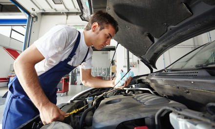 1 or 3 Oil Changes with Tire Rotation, Brake Inspection & Battery Test at Diagnostics Unlimited (Up to 77% Off)