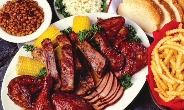 Woody's Bar-B-Q - Baymeadows Center: Barbecue Meals for Two or Four or $20 Worth of Barbecue at Woody's Bar-B-Q (Up to 45% Off)