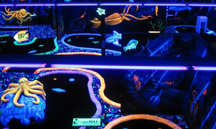U-Puttz Black Light Miniature Golf - Weston Shops: Mini Golf for 4, 6, or 8  or Birthday-Party Package at U-Puttz Black Light Miniature Golf (Up to 57% Off)
