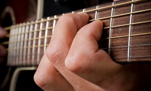 Guitar Lessons with Angelo: Four or Eight Guitar Lessons (Up to 65% Off)