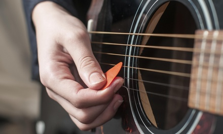 Four 30-Minute Guitar Lessons at Happy Minds School of Music (41% Off)