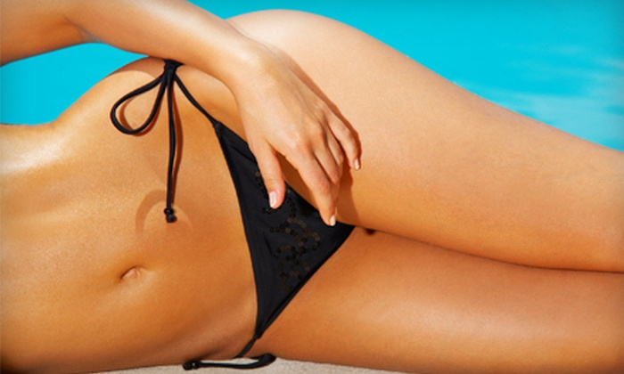 Coco Beach Tanning Studio - Mount Pearl: Two Weeks of Unlimited Tanning on Any Bed or Two Spray Tans at Coco Beach Tanning Studio (Up to 51% Off)