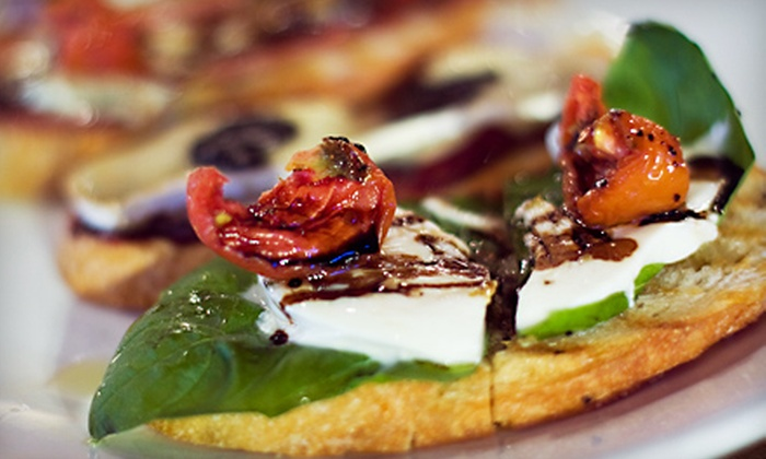 Timo - North Mountain: Three-Course Dinner for Four or $7 for $15 Worth of Tapas, Wood-Fired Fare, and Wine at Timo