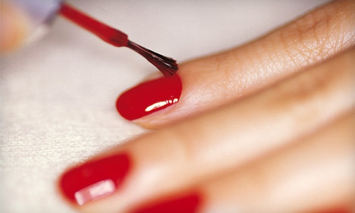 Exquisite Nail Boutique - Loop: $30 for No-Chip Manicure, Exfoliating Treatment, and Hand Massage at Exquisite Nail Boutique ($65 Value)