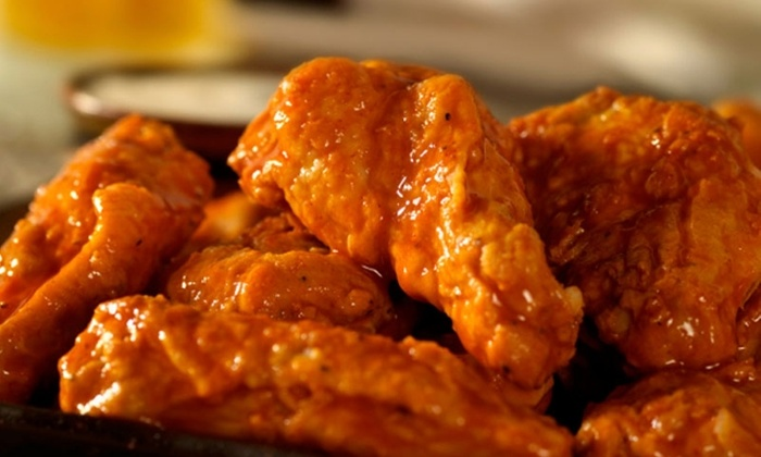 Titans Twisted Tavern - Calgary: $15 for $30 Worth of Pub Fare and Pours at Titans Twisted Tavern