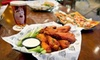 Tilted Kilt - University: $10 for $20 Worth of Pub Fare and Drinks at Tilted Kilt