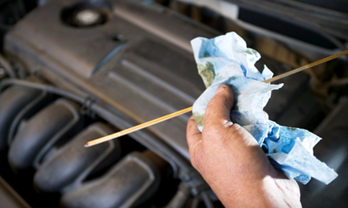 Drag-In Automotive - Multiple Locations: Oil Change, Oil Change with Tire Rotation, or Oil Change, Tire Rotation, and Fuel Injection at Drag-In Automotive