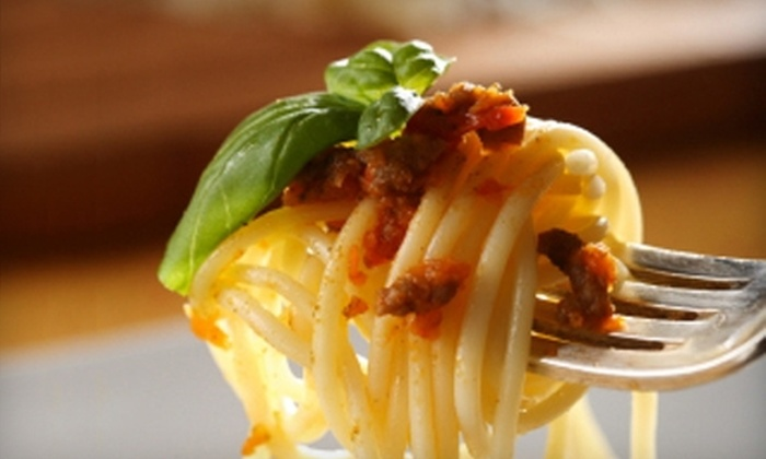 Figaro's Restaurant - East Carrollton: $25 for $50 Worth of Italian Cuisine and Drinks or $11 for a Carryout Pizza (Up to $19.50 Value) at Figaro's Restaurant