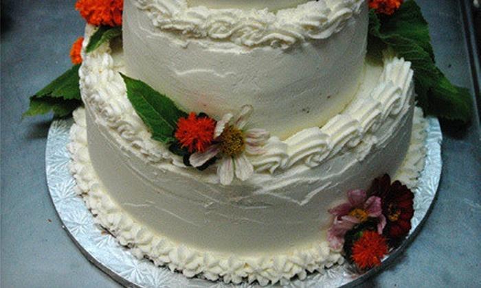Sugar Plum Vegan - Multiple Locations: 6-Inch Vegan Cake or One Dozen Vegan Cupcakes at The Sugar Plum Vegan (Half Off)