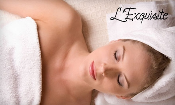 L'Exquisite Day Spa for Women & Men - Oakville: $50 for Body Exfoliation, Body Wrap, and Eyebrow Shaping at L'Exquisite Day Spa for Women & Men ($101 Value) in Oakville
