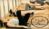 Vitality Pilates Studio - Multiple Locations: $49 for Seven 55-Minute Reformer Pilates Classes at Vitality Pilates ($134.50 Value)