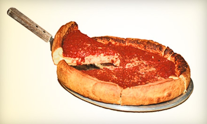 Mangia Pizza - Round Rock Original Plat: $10 for $20 Worth of Pizza, Burgers, and Wraps at Mangia Pizza in Round Rock