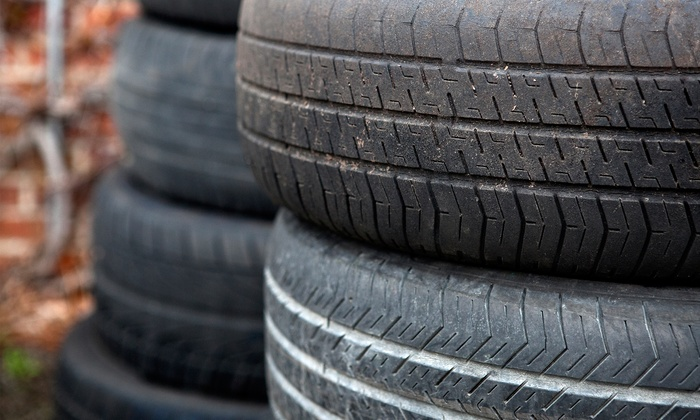 Ami-go Automotive - Milton: Four Tire Rotations and Oil Changes or Tire Alignment with Oil Change at Ami-go Automotive (Up to 56% Off)