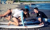 Rhody Surf, Inc - Middletown: Surfing or Paddleboarding Lesson for Two or Three with Wetsuit and Surfboard Rentals from Rhody Surf (Up to 55% Off)