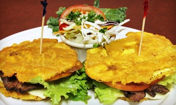 The Chez Olga - Eastown: $10 for $20 Worth of Creole and Caribbean Cuisine at The Chez Olga