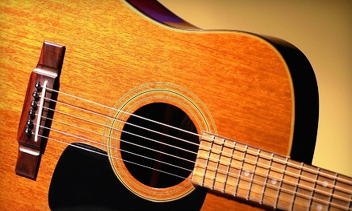 North Shore Guitar Academy - Wilmette: $89 for Four Weeks of Beginners Guitar Lessons Plus Rental from North Shore Guitar Academy in Wilmette ($180 Value)