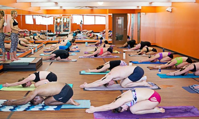 Bikram Yoga Kelowna - Central City: 5 or 10 Bikram-Yoga Classes, or One Month of Unlimited Classes at Bikram Yoga Kelowna (Up to 65% Off)