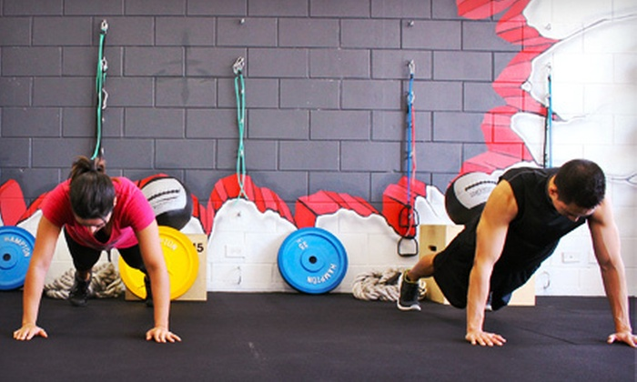 E C Fitness - Puck's Alley: 4, 8, or 14 One-Hour Warrior Fitness Classes at E C Fitness (Up to 69% Off)