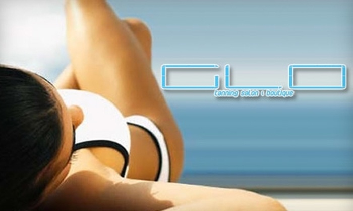 Glo Tanning Salon & Boutique - Lakeview: Half Off Five Spray Tans or Ten Tanning Bed Sessions at Glo Tanning Salon & Boutique. Choose From Four Options.