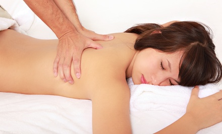 60-Minute Deep-Tissue Massage and a Decompression Exam from Impact Massage (49% Off)
