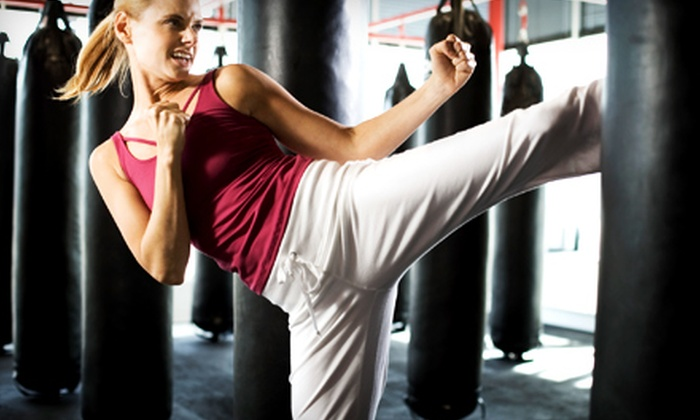 Modern Martial Arts - Multiple Locations: $29 for Four Adult Kickboxing Classes and Gloves ($115 Value) or Three Children's Martial-Arts Classes and Uniform at Modern Martial Arts ($150 Value)