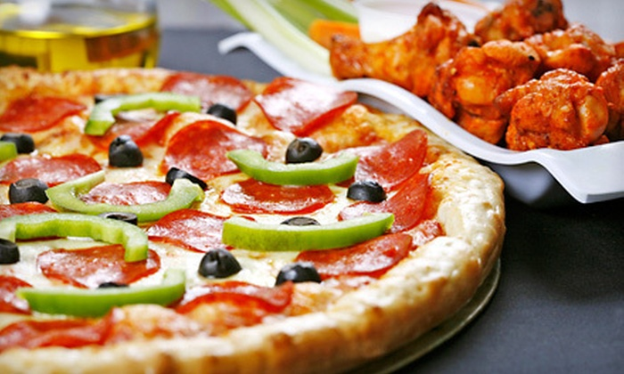 Cambridge Pizza - Cambridge: Regular or Gluten-Free Pizza Meal with Wings or Garlic Bread and Two Cans of Pop at Cambridge Pizza (Up to Half Off)